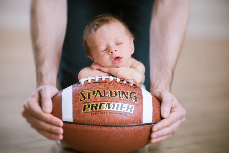 nashville newborn photographers,  UK newborn photography, University of Kentucky baby pictures, newborn posed on football, newborn posed on basketball